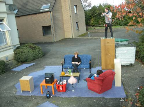 George, Ane and Malte enjoying tea and tv outside, House Home project, Shore Road, Belfast, November 2008.